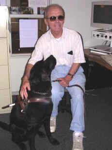 Jerry, N0VOE, and Guide Dog Trawler in the handiham office